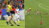 BOOM! Baneløber får vagter på stribe til at glide - så bliver han hamret ned med football-tackling
